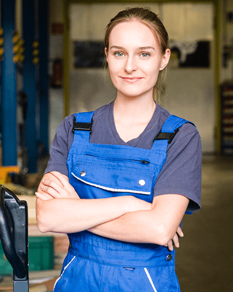 Female mechanic standing in the entrance of garage -Plusnet Business